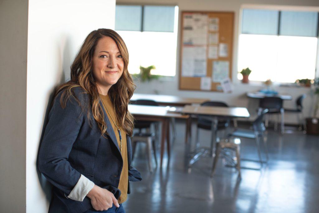 Picture of teacher at door of empty classroom