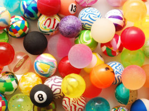 Picture of colourful soft balls.  Some with numbers on.