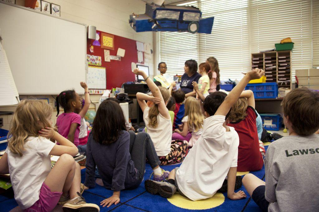 Picture of primary school children in classroom with teacher