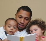 Picture of father reading to two young children