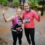 Kate in running kit with friend
